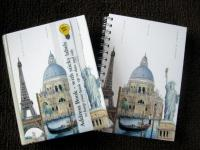 The world travel address book and spiral notebook.